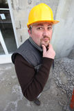 Pensive builder Royalty Free Stock Photo