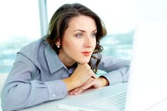 Pensive business lady Stock Images