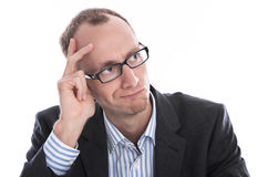 Pensive business man with glasses in suit isolated on white. Royalty Free Stock Photo