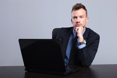 Pensive business man at laptop Royalty Free Stock Photography