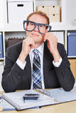 Pensive business man with nerd Stock Photo