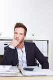 Pensive business man in office Royalty Free Stock Images
