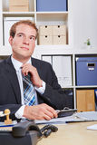 Pensive business man in office Stock Photos