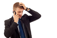 Pensive business man on the phone Royalty Free Stock Images