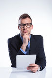 Pensive business man with tablet Stock Images