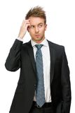 Pensive business man touching face Stock Photo