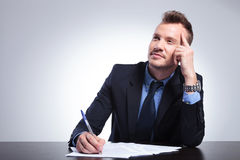 Pensive Business Man Writes A Letter Royalty Free Stock Images