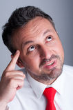 Pensive business person having an idea Stock Photo