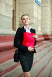 Pensive business woman with a folder Royalty Free Stock Photography