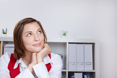 Pensive business woman looking up Royalty Free Stock Photos