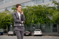 Pensive business woman at the modern office district Royalty Free Stock Images
