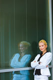 Pensive business woman near office building Royalty Free Stock Photography