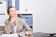 Pensive business woman in office Royalty Free Stock Photos