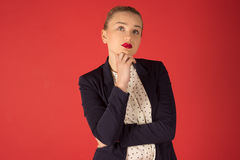 Pensive business woman. On a red background Royalty Free Stock Image