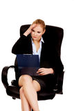 Pensive business woman sitting on armchair and reading notes Royalty Free Stock Image