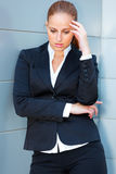 Pensive business woman standing at office building Royalty Free Stock Photo