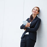 Pensive business woman with tablet Stock Photos