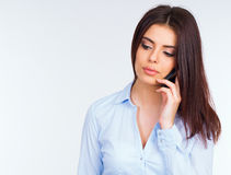 Pensive business woman talking on the phone Stock Images