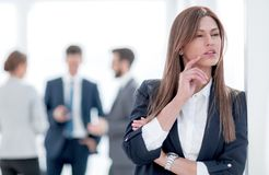 Pensive business woman on blurred office background. Pensive business women on blurred office background. photo with copy space stock images