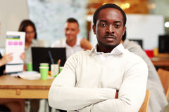Pensive businessman with arms foldeds Stock Photos
