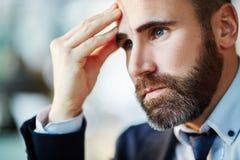 Pensive businessman Royalty Free Stock Photos