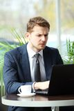 Pensive businessman in a cafe Royalty Free Stock Photos