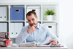 Pensive businessman calculates taxes Royalty Free Stock Photo