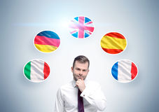 Pensive businessman and country flags Royalty Free Stock Image