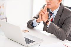 Pensive businessman Stock Image
