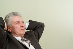 Pensive businessman is dreaming in the office Stock Image