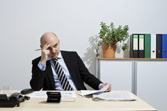 Pensive businessman Royalty Free Stock Photo
