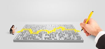 Businessman in front of a maze with solution Stock Image