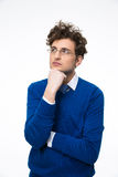 Pensive businessman in glasses looking up Stock Image