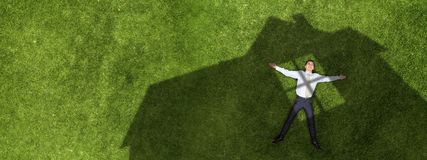Pensive businessman on grass royalty free stock photography