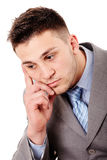 Pensive businessman with hand on chin Stock Photography