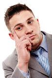 Pensive businessman with hand on chin Stock Images