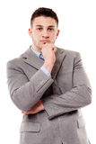 Pensive businessman with hand on chin Royalty Free Stock Photography