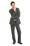 Pensive businessman with hand near face Stock Images