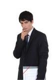 Pensive businessman holding file Stock Photos
