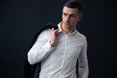Pensive businessman holding jacket on shoulder Stock Images