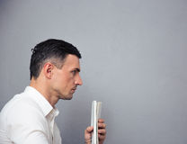 Pensive businessman holding newspaper Royalty Free Stock Image