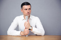 Pensive businessman holding newspaper Royalty Free Stock Photography
