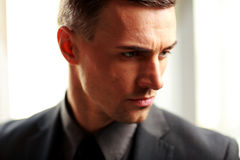Pensive businessman looking away Royalty Free Stock Photography