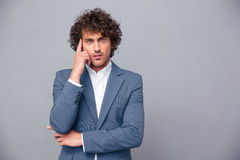 Pensive businessman looking at camera Royalty Free Stock Photography