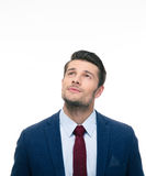 Pensive businessman looking up at copyspace Stock Photos