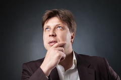 Pensive businessman looking up Royalty Free Stock Image