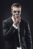 Pensive businessman with makeup skeleton Royalty Free Stock Photos