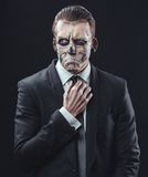 Pensive businessman with makeup skeleton Royalty Free Stock Image