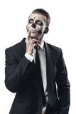 Pensive businessman with makeup skeleton Royalty Free Stock Photography