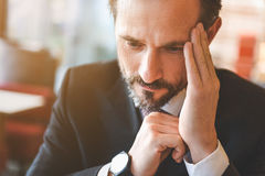 Pensive businessman making decision with seriousness Stock Image